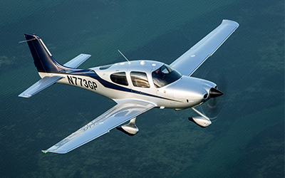 cirrus aircraft flying in the sky