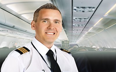 A male pilot smiling