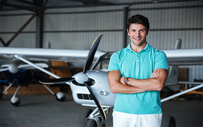 A man standing in front of a cirrus airplane